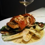 Barramundi wrapped in bacon on bok choy and haloumi side
