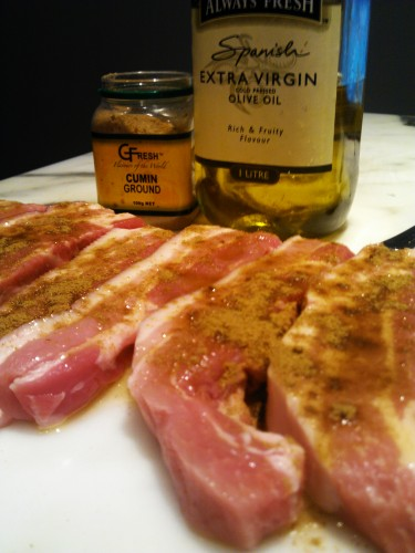 Pork strips with extra virgin olive oil and cumin