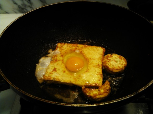 Haloumi frying with egg in it