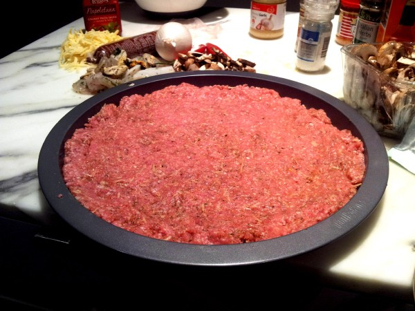 meatza base in a pan